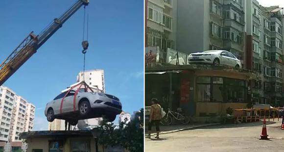 """女司机与保安冲突停车堵门 物业雇吊车让其""""上天"""""""